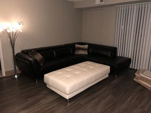 Leather sectional and ottoman for Sale in Detroit, MI
