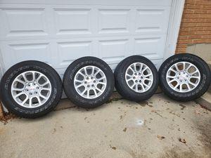 GMC Sierra 18inch rims with like new bridgestone tires for Sale in Sugar Grove, IL