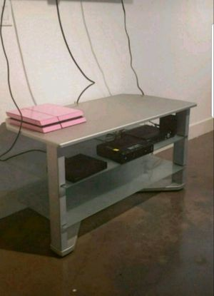 SILVER TV STAND WITH GLASS SHELVES for Sale in Dallas, TX