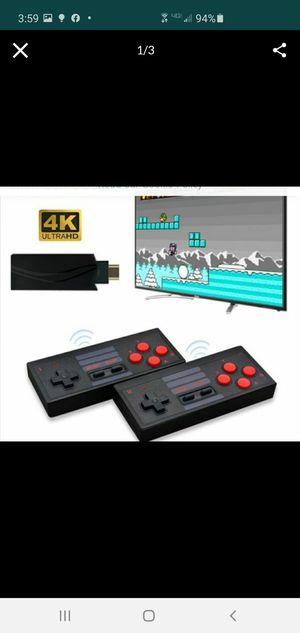 New mini console built in 628 games wireless controllers output dual players for Sale in Riverside, CA
