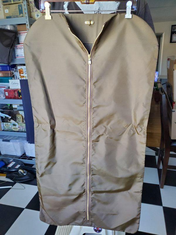 "Louis Vuitton Travel Garment Bag Brown, nylon garment bag with gold, metal ""LV"" logo zip"