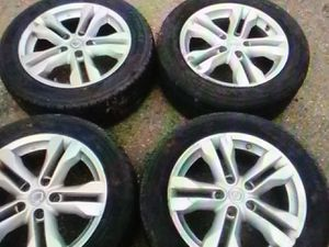 2013 Nissan rouge tires and rims for Sale in Burlington, NJ