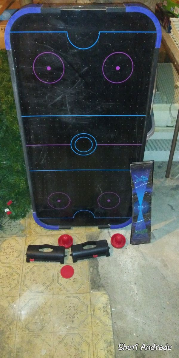 Air hockey table that stands about three and a half feet 4