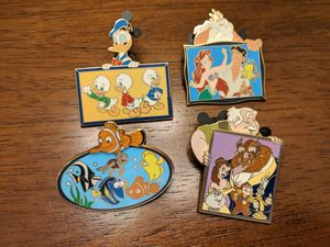 Disney shopping limited edition pin of 250. Set of four pins from The Father's day portrait series in 2007. for Sale in Glendale, AZ