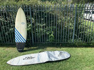 Surfboard and travel bag for Sale in Houston, TX