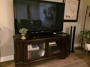 Dark wood tv stand console with glass doors and shelves for Sale in Yucaipa, CA