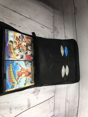 Leather case of 46 original Disney movies blue rays dvds for Sale in Orlando, FL