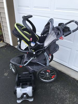 Baby trend jogging stroller with car seat and base for Sale in Beaverton, OR