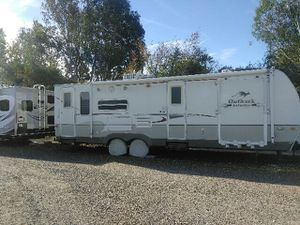 2008 28' OUTBACK TRAVEL TRAILER WITH TOYHAULER. QUEEN BED & DINNING POPOUT for Sale in Laguna Beach, CA