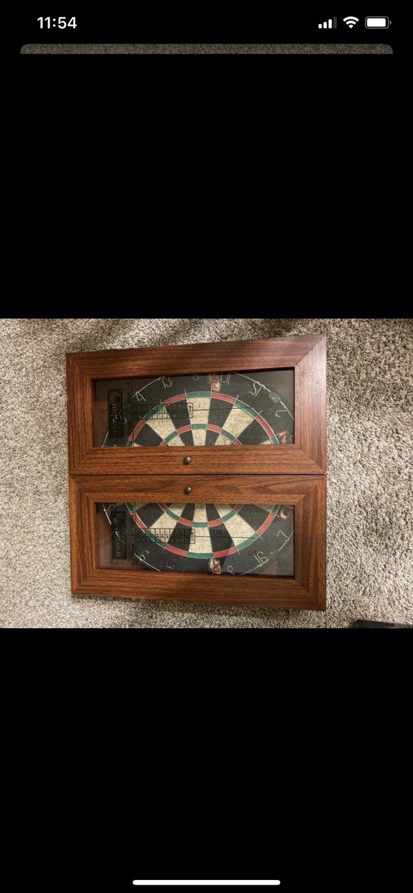 Dart board with scoreboard cabinet