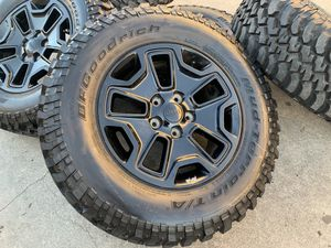 """17"""" Jeep Wrangler Rubicon Gladiator 5x5 rims wheels with Mud tires for Sale in Rio Linda, CA"""