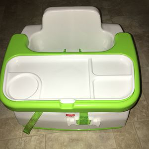 Fisher price booster seat with built in tray and carrying straps for Sale in Tacoma, WA