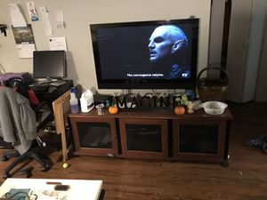 Lower cabinet with an support system to hold this tv both for $1200 for Sale in Portland, OR