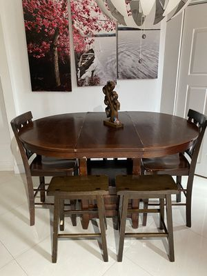 Wood two size table with 4 branches and 2 chairs for Sale in North Miami, FL