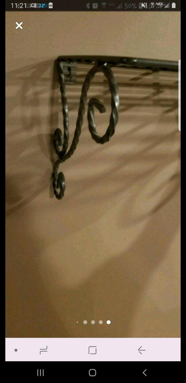 3 wrought iron wall shelves