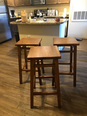 Three wood stools for Sale in Orlando, FL