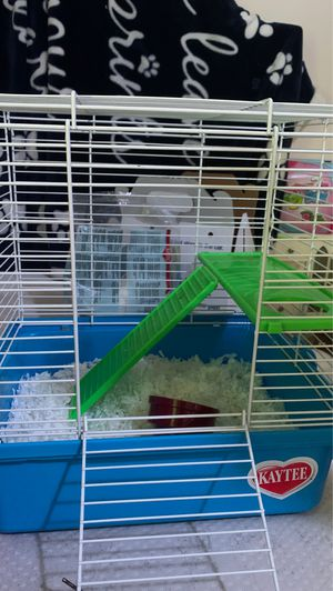 cage with food cup for small animals and a wheel for Sale in Bay City, MI