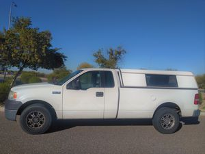WORK TRUCK 2006 FORD F150. with camper shell tow package SIMILAR TO GMC SIERRA Chevy silverado dodge ram. nissan titan. toyota tundra. ford ranger for Sale in Phoenix, AZ