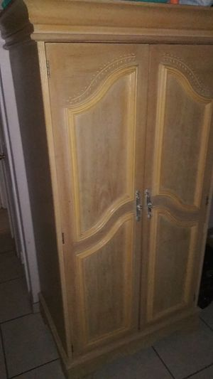 Wood closet for Sale in Maricopa, AZ