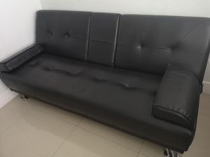 Black bonded leather futon, reversible with cupholder. Good condition!! for Sale in Miami, FL