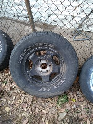 95 to 99 Tahoe suburban 6 lug rim and tire for Sale in St. Louis, MO