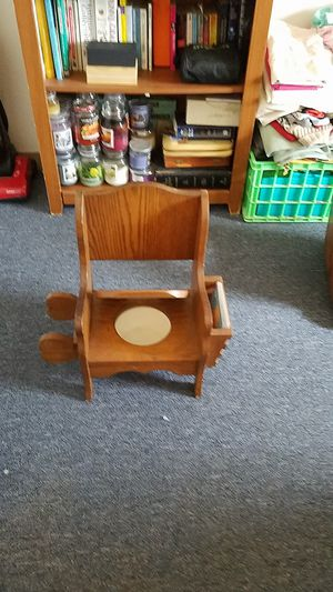 Antique potty chair w/ book holder an toilet roll holder . $50.00 for Sale in Virginia Beach, VA
