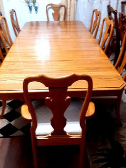 Beautiful solid wood dining room table with 8 chairs sets. GOOD CONDITION 🌹 Table have 4 leaves Each leaf 11.5 inches Long table with leaves 112 in for Sale in Houston,  TX