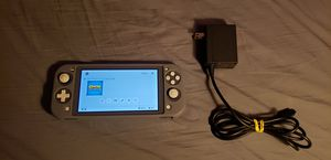 Grey Nintendo Switch Lite with charger and protector for $160 for Sale in Las Vegas, NV