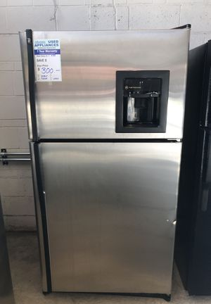 Stainless top freezer refrigerator with water and ice dispenser for Sale in Denver, CO