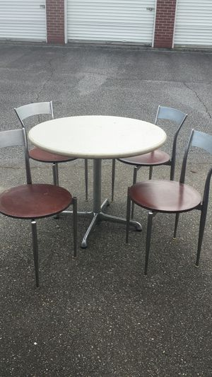 Table & 4 stainless steel chairs with wood bottom for Sale in Greenville, SC