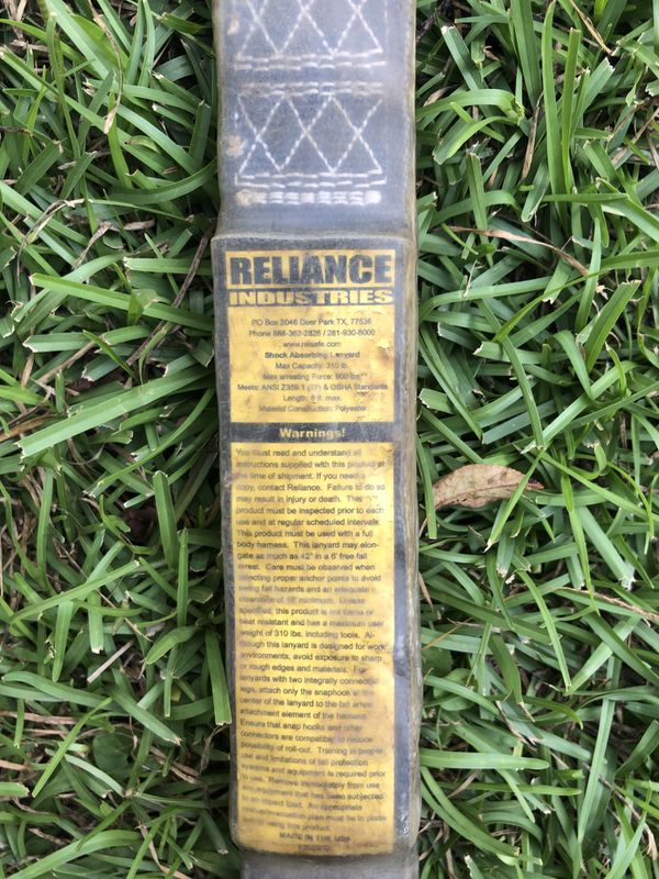 Reliance shock absorbing lanyard