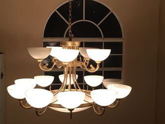 Beautiful and elegant chandelier 1 large light at bottom then 10 lights on second row and 5 lights on third row for Sale in Miami,  FL
