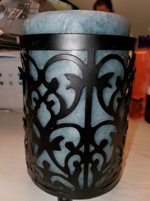 Black candle holder and never used candle for Sale in Fairfield, OH
