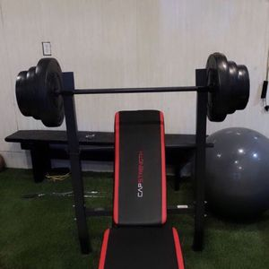 Gym Equipment Adjustable Bench press, barbell, leg developer and 100lbs of weight for Sale in Montebello, CA