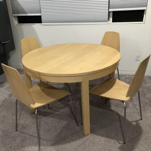 Ikea extendable dining table with 4 chairs for Sale in Ontario, CA