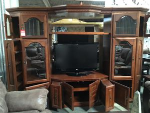 Floor sample solid wood Large Entertainment Center for Sale in High Point, NC
