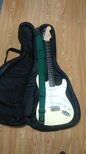 Electric Guitar/Squier Fender comes with bag and strap for Sale in Homestead, FL