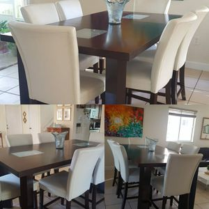 Height Dining wood expandable table with six white faux leather chairs for Sale in Miami, FL