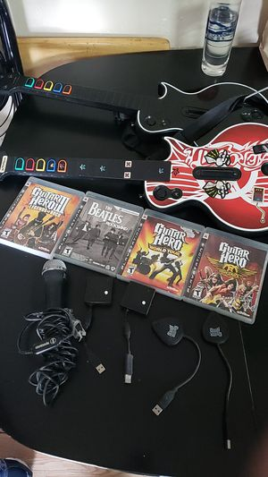 Ps3 Guitar hero everything works..2 guitars 1 mic all hardware and 4 games.. for Sale in Los Angeles, CA