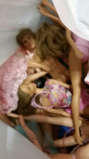 Used barbie dolles and nice clothes.Top barbie dolles aee the last picture for Sale in Normal, IL