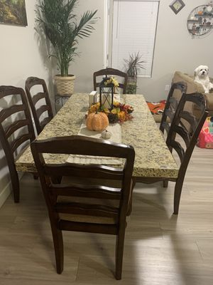 Miter Granite Dinning Room Table and 6 Antique Wooden Chairs for Sale in Salt Lake City, UT