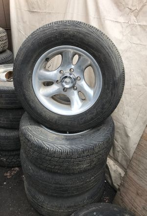 """4 16"""" alloy wheels / rims 6x5.5 Chevy 235/70/16 tires set 65% for Sale in Portland, OR"""