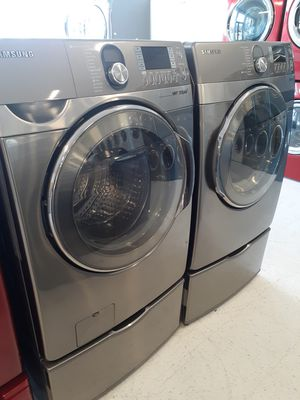Samsung front load washer and electric dryer set in good condition with pedestal with 90 day's warranty for Sale in Mount Rainier, MD