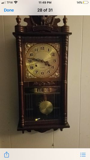 Vintage clock with eagle on top wind up with pendulum for Sale in Gulfport, MS