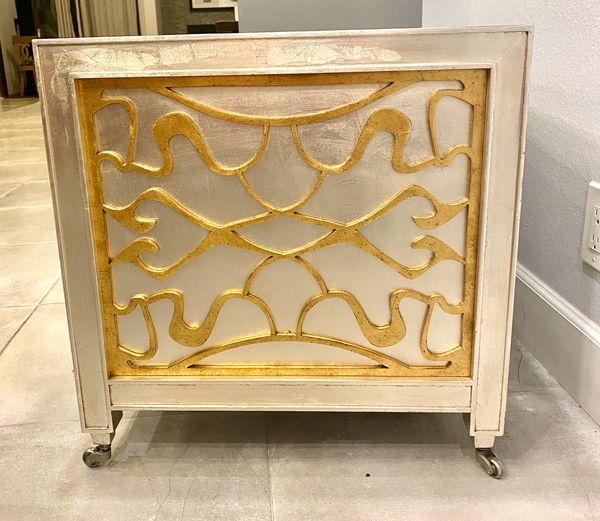 Mid century coffee table with golden trims designed by Vaughan Benz