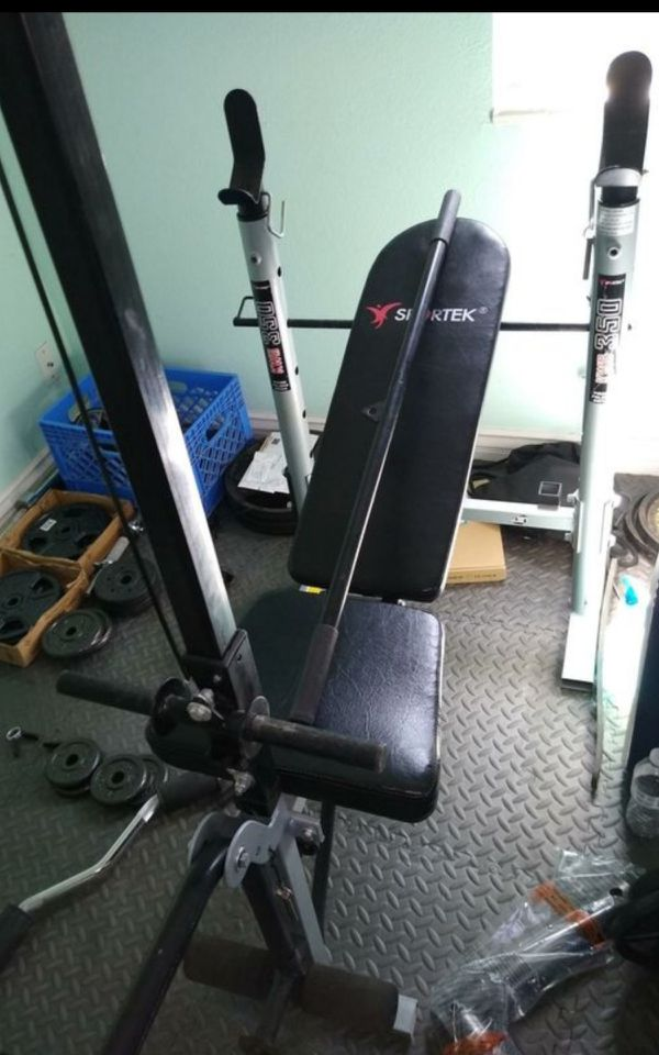 Home gym or weight bench with leg and arm attachments