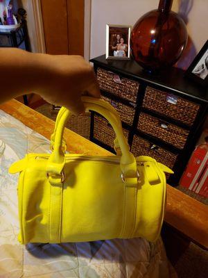 Very bright cute medium size yellow purse for Sale in Buffalo, NY