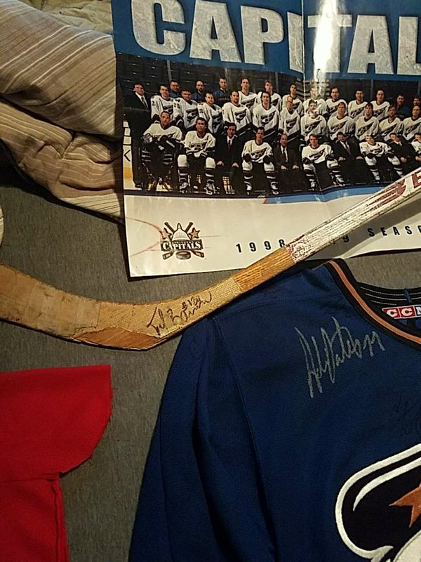 Washington capitals signed jeresy from the 98-99 teams hockey stick signed and also practice jersey signed