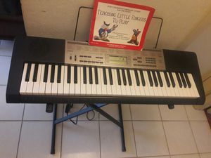Piano keyboard with stand for Sale in Houston, TX