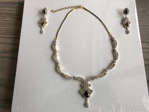 Cubic zirconia and semi-precious stone on silver and gold-plated chain for Sale in Clarksburg, MD